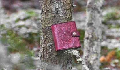 Red leather wallet with fairy image
