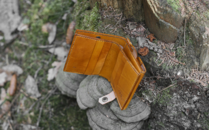 Yellow leather wallet with geko image