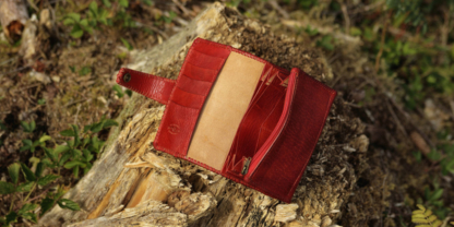 Large red leather wallet for women with hand carved swallows and feather image.