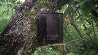 Leather wallet with eagle image, coin pocket.