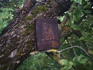 Dark brown leather wallet, decorated by hand carved eagle image.