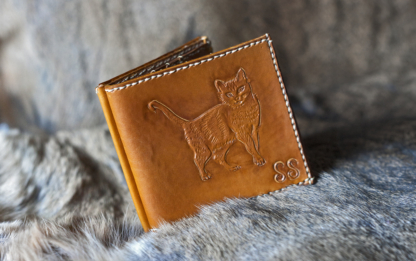 Yellow leather wallet with a cat