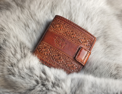 Full grain leather wallet with hand carved folk pattern