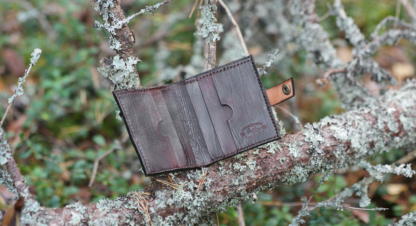 Dark brown leather wallet with ram