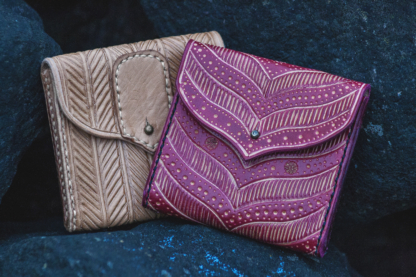 Leather small wallets with pattern.