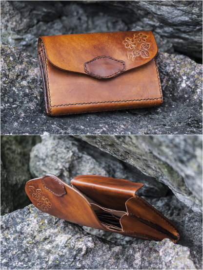 Brown women's wallet with hand carved flowers