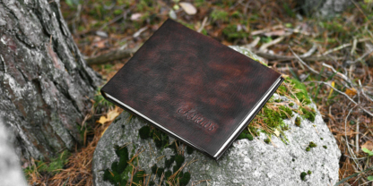 Leather cased photo album with name