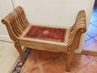 Yuyu chair with a leather seat cover
